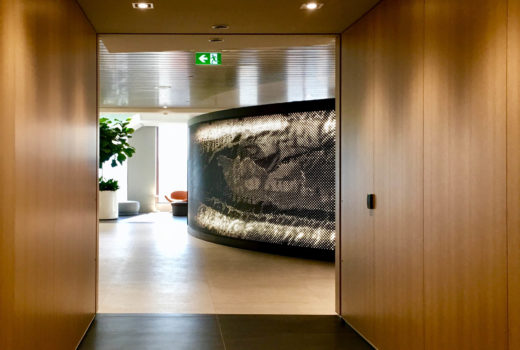Arktura Graphic Perf backlit on a curved wall