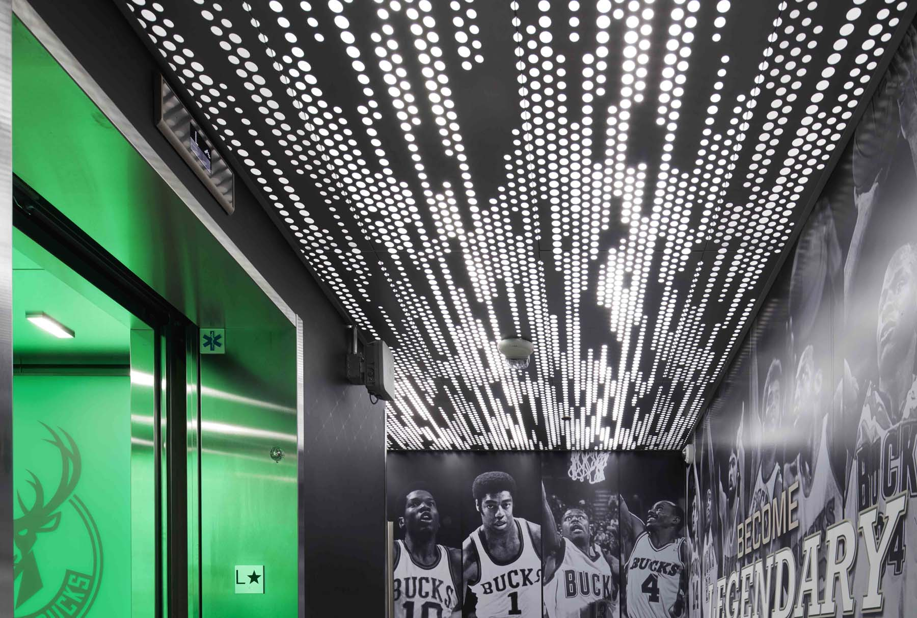 Arktura Vapor® Trail Ceiling and Wall Panel System with Arkluma™ Backlight Milwaukee Buck Training Center Greenbay, Wisconsin
