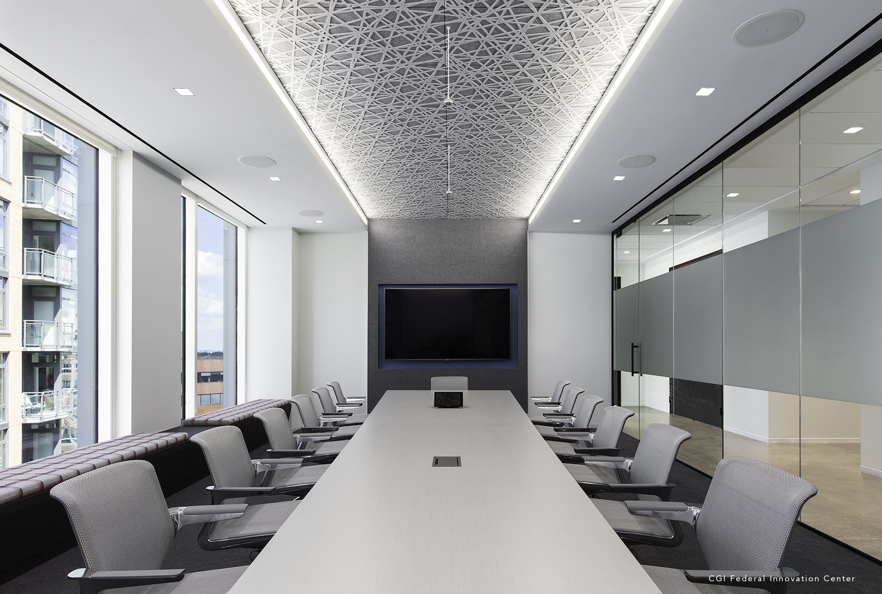 Trace® Straight installed with cove lighting in conference room.