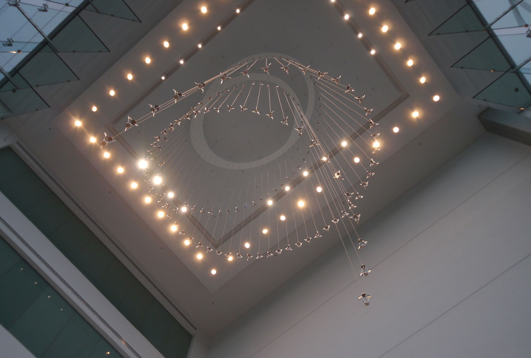 Chandelier made with kinetic pendants of brushed steel by Gensler with Arktura Solutions Studio for Bayer HQ