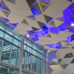 Close up of Arktura Solution Studio faceted acoustic ceiling in Town Hall for Noble Energy
