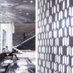 Close ups of Arktura Solution Studio perforated ceiling and wall panel in Koin Lobby
