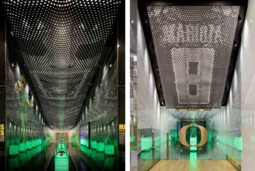 Views of Arktura Solutions Studio Marcus Mariota Center backlit, perforated ceilings.
