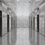Arktura Vapor Pixel backlit ceiling panels in an elevator lobby.